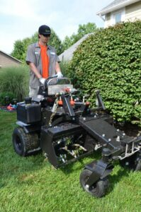 Alan-Aerating-199x300 Why Aerating, Seeding and Fertilizing in the Fall is Critical