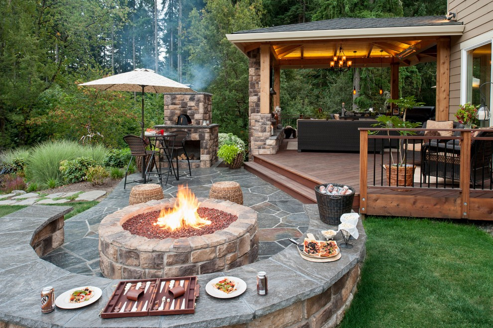 Backyard Designs With Fire Pit In Paver Patio Retainer Wall And Landscaping Lighting